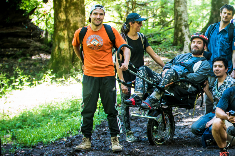 Group of visitors on the Pioneros trekking tour use a jolette all-terrain wheelchair