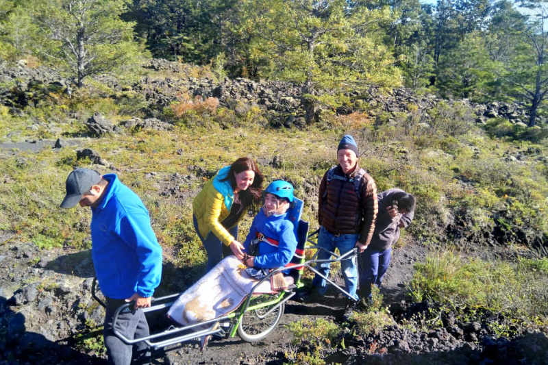 Group on the Pioneros trekking tour use the all-terrain Jolette wheelchair
