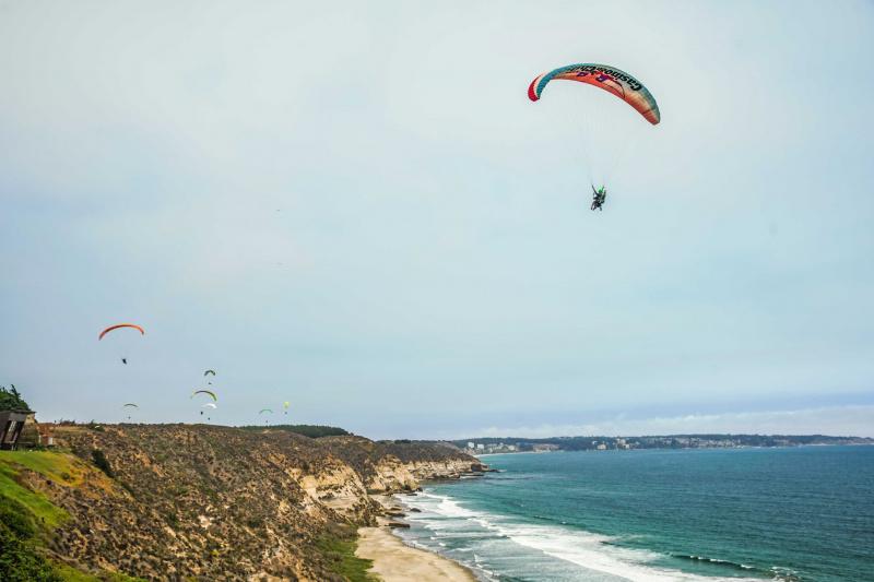 Multiple paragliders over Maitencillo.
