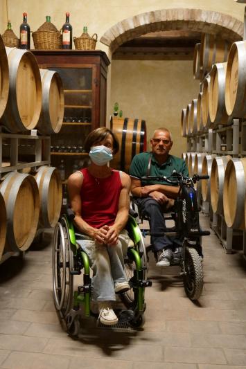 Travelers explore wine casks.