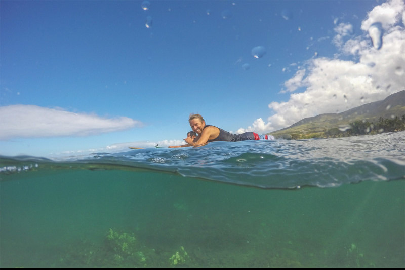 Surfing at clear waters