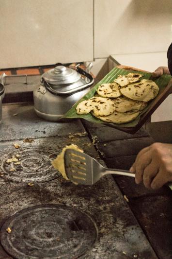 Guest prepares tortillas during cooking class.
