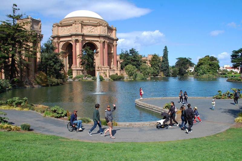 Wheel the World travelers enjoying Palace of Fine Arts and pond