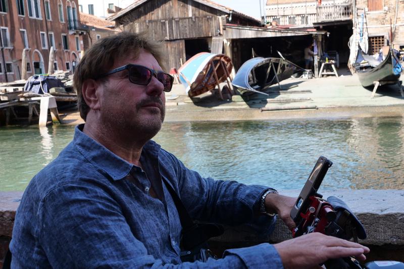 Man looks out over the San Trovaso gondola yard