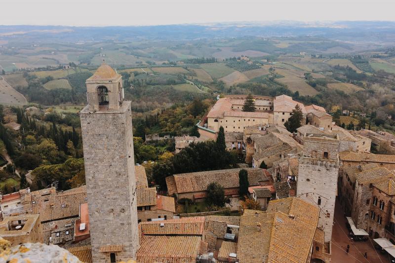 Mountainside view of San Gimignano and surrounding farms