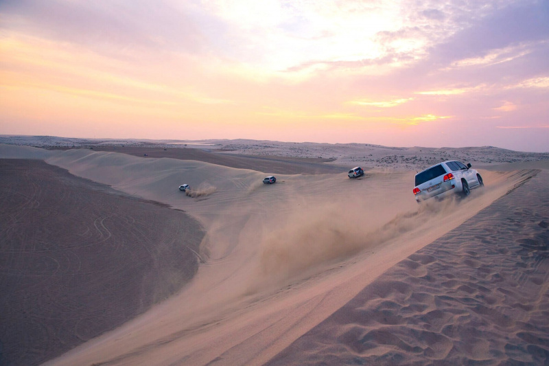 Race along the sand dunes in the off-road vehicles
