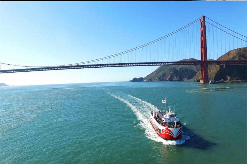 A boat returns after passing under the Golden Gate Bridge