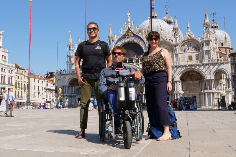 Group poses in the historic St Mark's square
