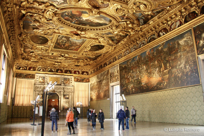 The Interior of Doge's palace has smooth flooring and large Venetian gothic style paintings