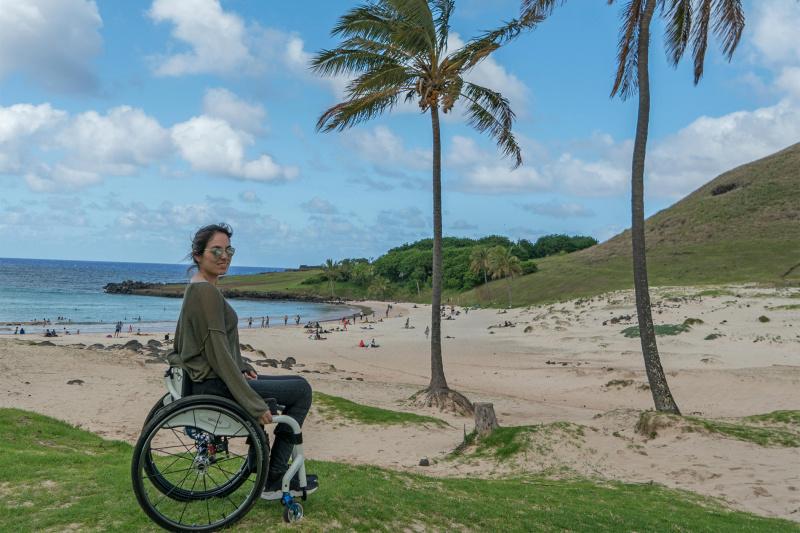 A woman in a wheelchair on Anakena Beach