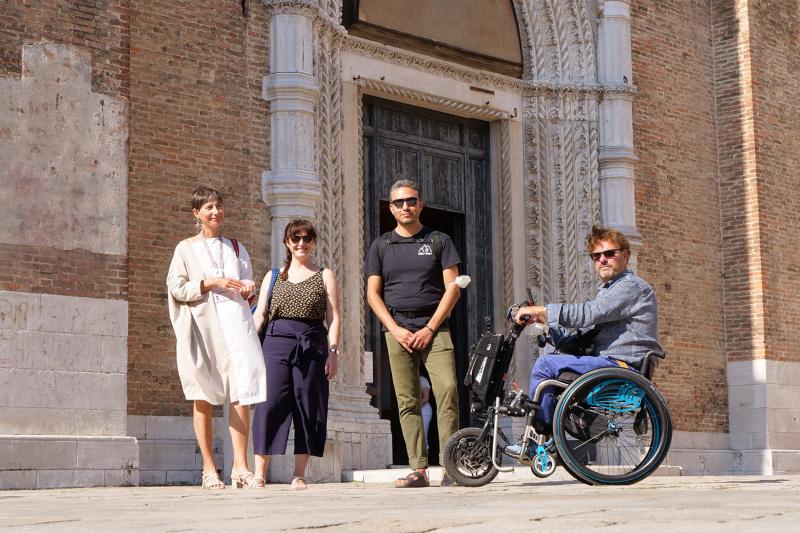 Tour participants sit and enjoy Campo dei Frari