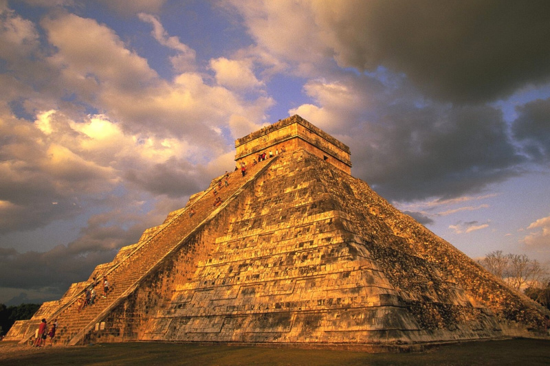 The Chichen Itza pyramid lit up by sunlight.