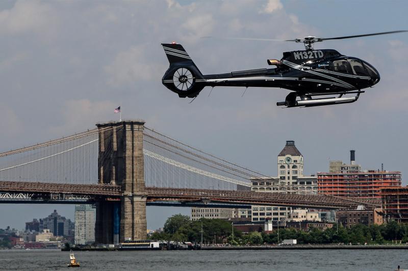 Helicopter flies around the Brooklyn Bridge