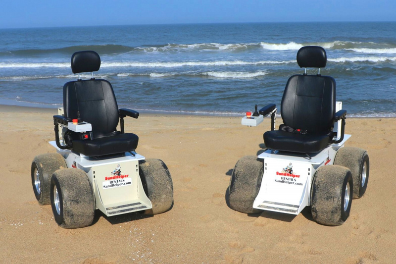 Two electric beach wheelchairs