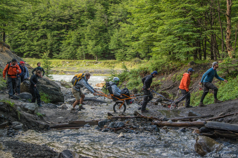 Crossing a small river with a joëlette wheelchair