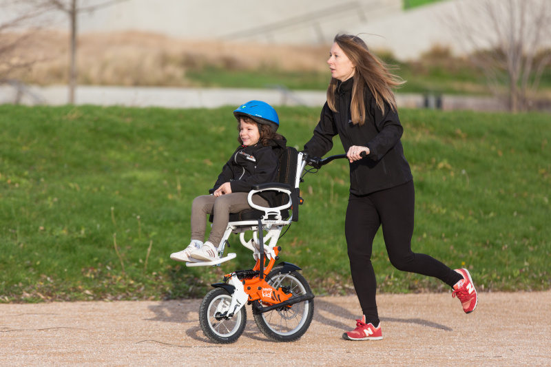 Enjoying an outdoor activity and family day with a joëlette kids wheelchair