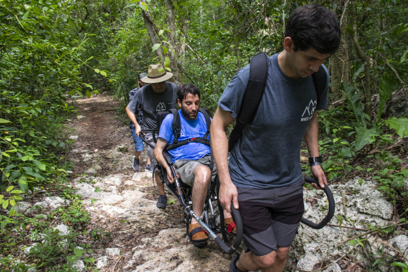The joëlette wheelchair allows people with reduced mobility to hike and navigate uneven terrain.