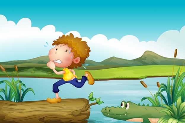 Peuter rent weg voor een krokodil