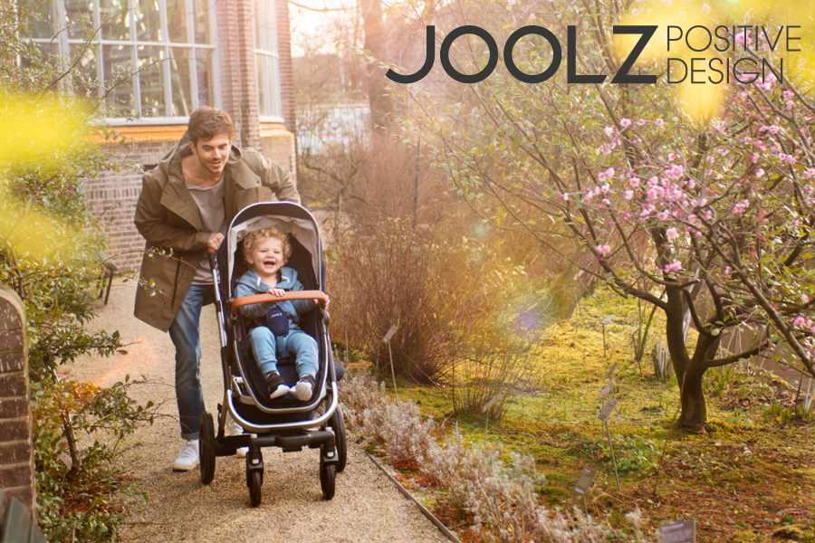 Vader met een Joolz kinderwagen