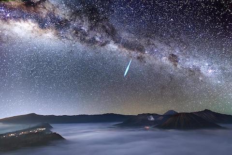 3032579-slide-eta-aquarid-meteor-shower-over-mount-bromo-justin-ng