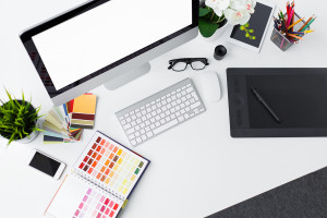 Photo of creative professional designer's desk top from above