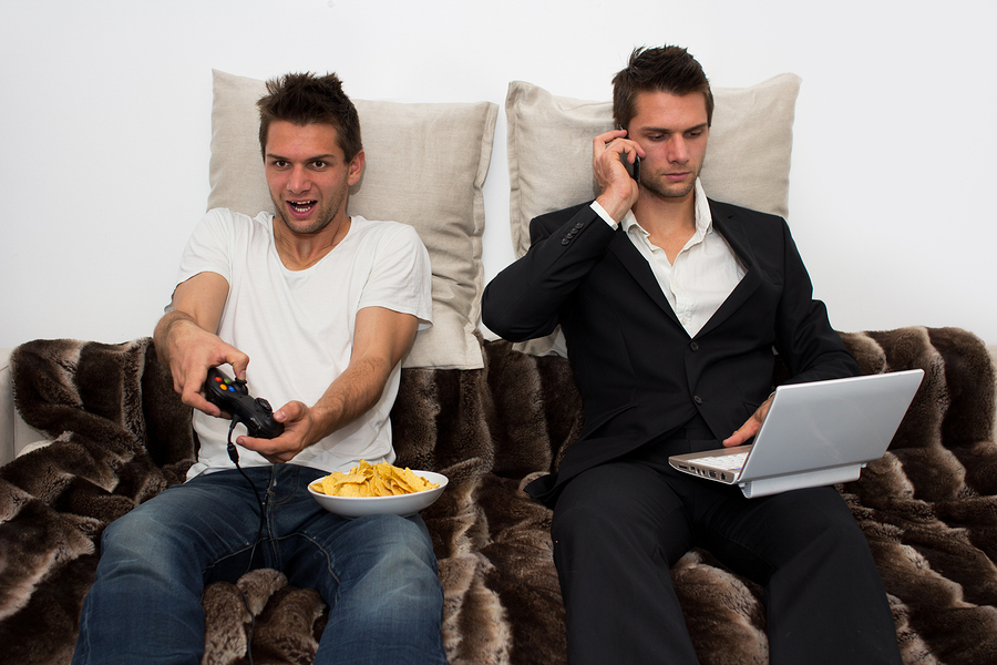 Gamer and Businessman side by side on the couch