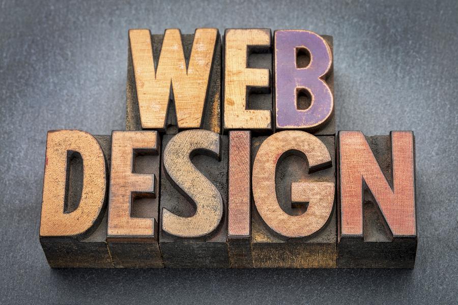 web design banner - text in vintage letterpress wood type against slate stone