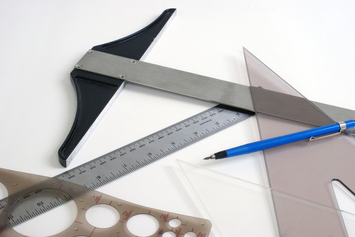 An assortment of graphic design tools on white background.