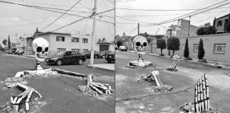 El colectivo 'Indios Yaocalli' creó estas calaveras gigantes que simulan salir de las calles, la instalación forma parte de un festival de Día de Muertos.