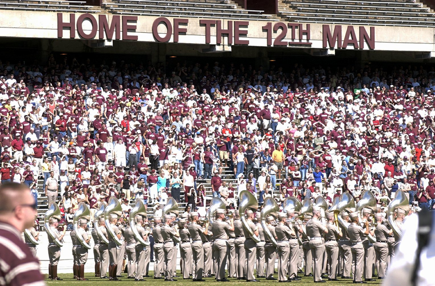 "** FILE ** Texas A&M fans fill the first tier of stands during the Maroon and White game, in this  April 12, 2003 photo, in College Station, Texas.  As if the Terrible Towel-twirling faithful of the Pittsburgh Steelers weren't enough, now Seattle Seahawks fans have to ward off another set of rabid football partisans: the Aggies of Texas A&M. Ever since the university launched a trademark dispute this week over who is allowed to refer to their fans as the ""12th Man,"" David Israel, president of the Seahawks' official fan club, has attracted plenty of abuse. (AP Photo/Bryan-College Station Eagle, Butch Ireland)"