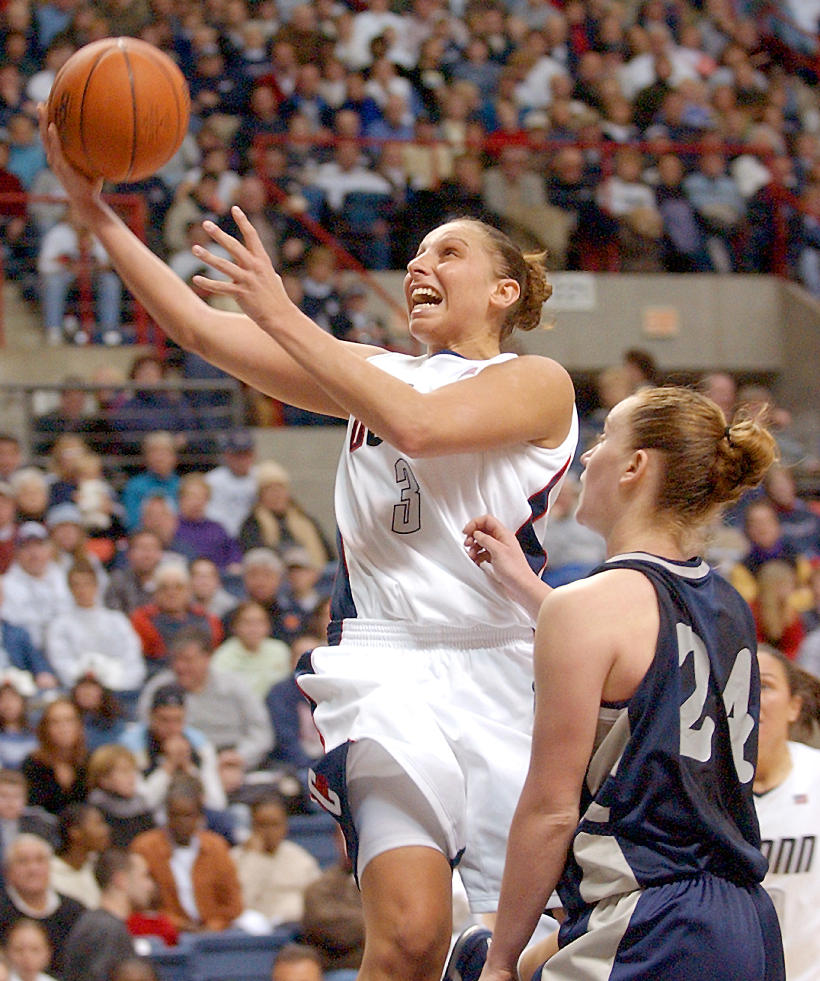 ** ADVANCE FOR WEEKEND EDITIONS, FEB. 19-20 -- FILE -- ** University of Connecticut's Diana Taurasi (3) goes to the basket against Georgetown's Bethany LeSueur in Storrs, Conn., in this 2004 phoito. With Taurasi gone, the Connecticut women's team has lost their stranglehold on the women's game. (AP Photo/Bob Child/files)