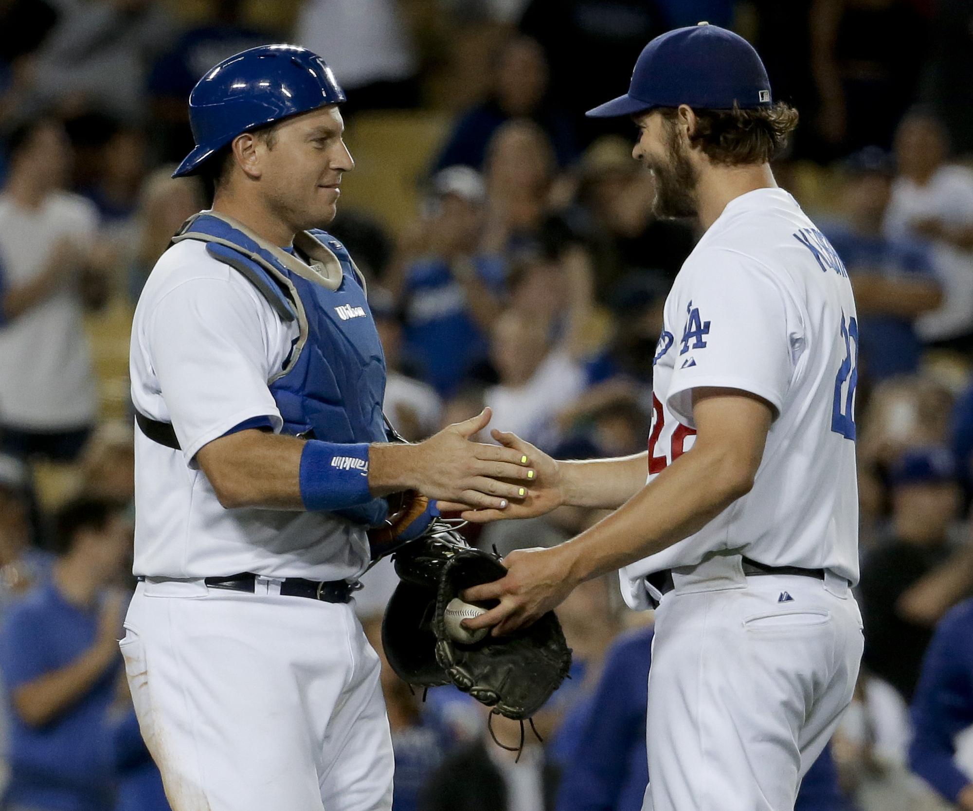 Los Angeles Dodgers starting pitcher Clayton Kershaw, right, celebrates with catcher A.J. Ellis after pitching a shutout against the Philadelphia Phillies during a baseball game in Los Angeles, Wednesday, July 8, 2015. The Dodgers won 5-0. (AP Photo/Chris Carlson)