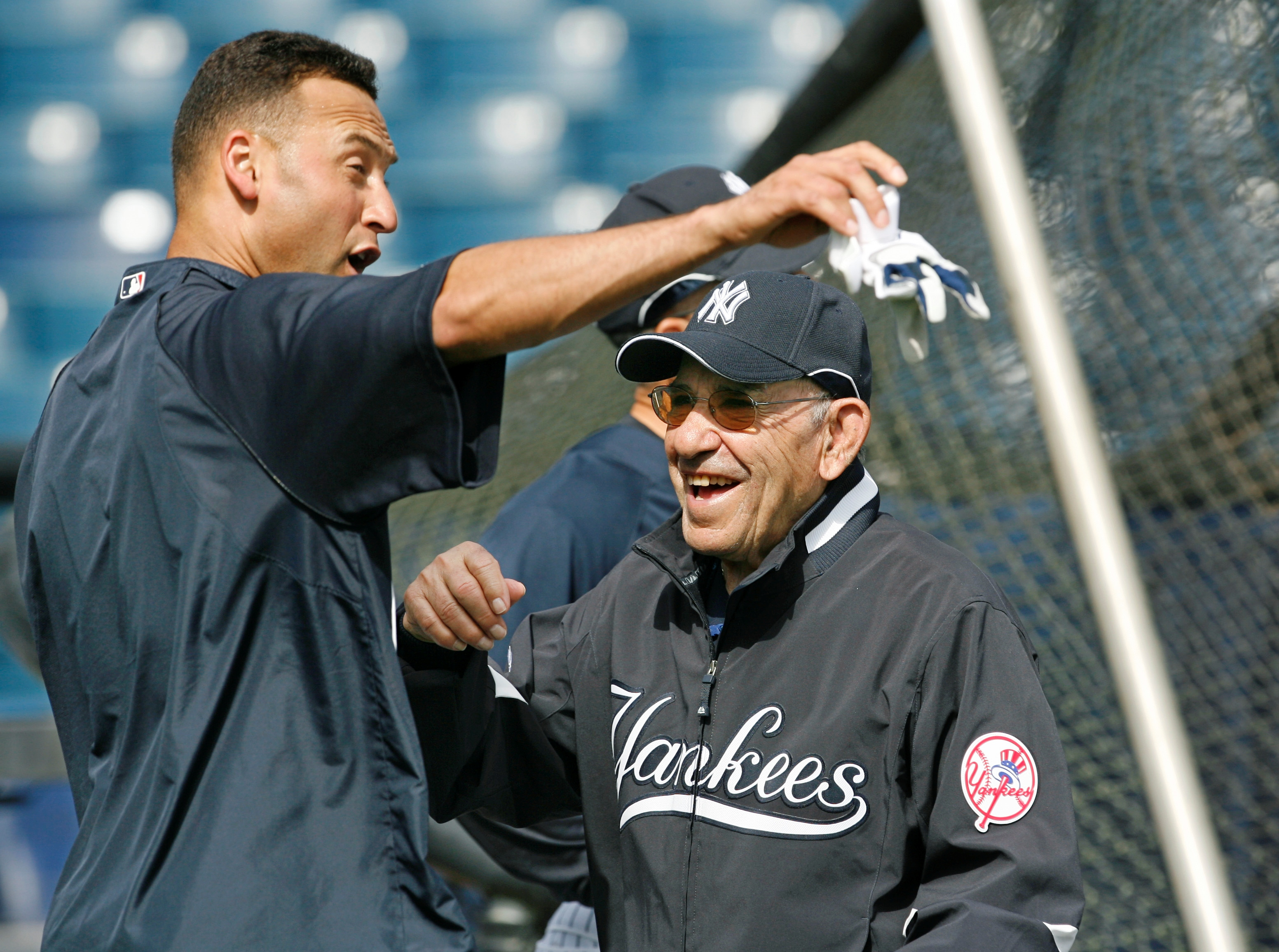 File-This March 7, 2008, file photo shows New York Yankees shortstop Derek Jeter, left, and Yogi Berra clowning around by the batting cage before the Yankees spring training baseball game against the Houston Astros at Legends Field in Tampa. Berra, the Yankees Hall of Fame catcher, has died. He was 90. (AP Photo/Kathy Willens, File)