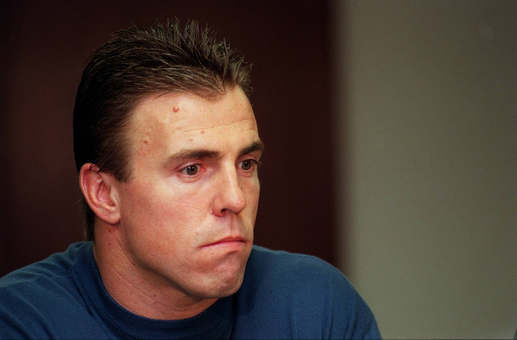 Bill Romanowski listens to his attorney talk to the press during a press confrence about his involement of taking prescription drugs.  (Photo By John Leyba/The Denver Post via Getty Images)