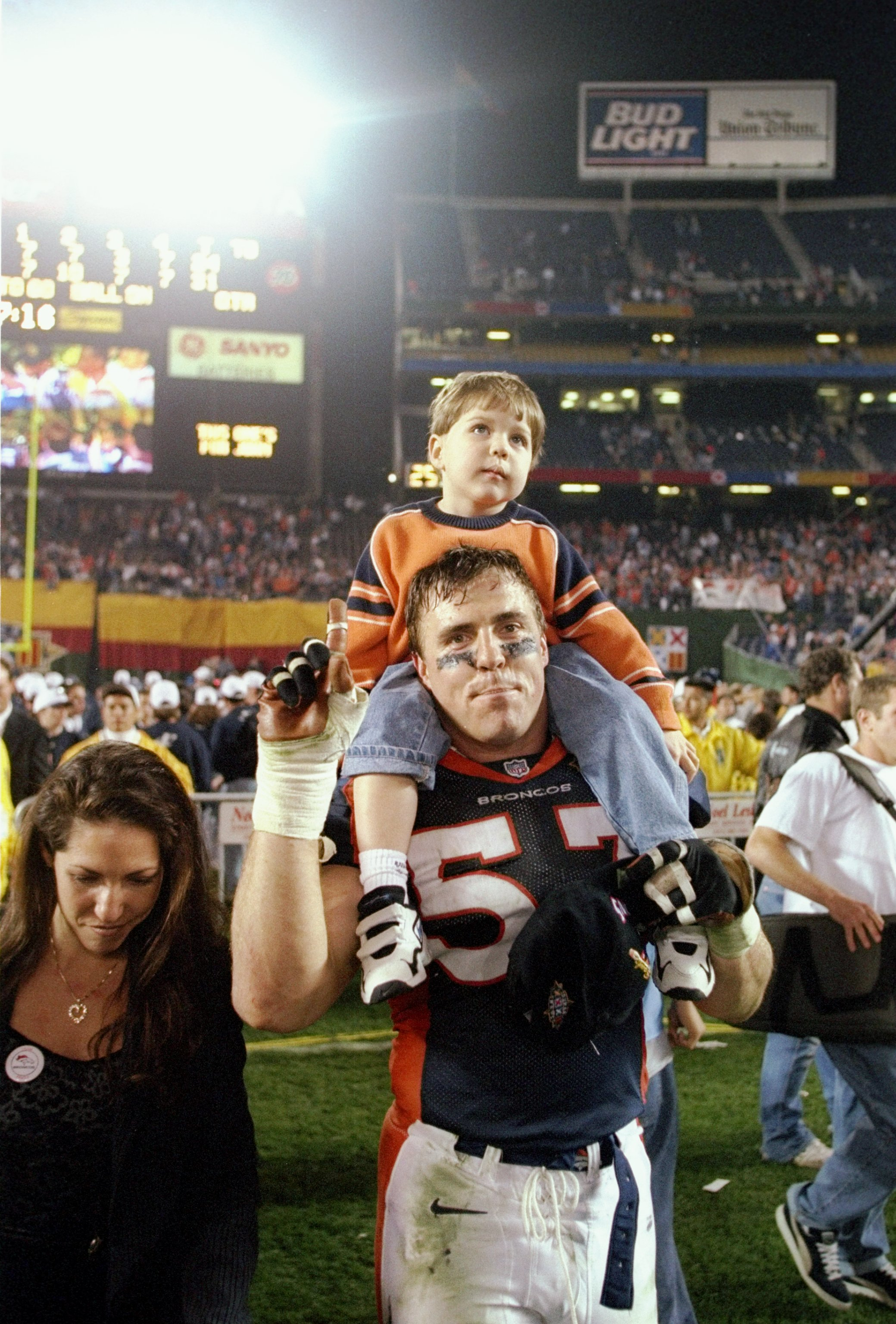 25 Jan 1998:  Bill Romanowski #53 of the Denver Broncos celebrates with his son after defeating the Green Bay Packers in Super Bowl  XXXII at Qualcomm Stadium in San Diego, California.  The Denver Broncos defeated the Green Bay Packers 31-24. Mandatory Cr