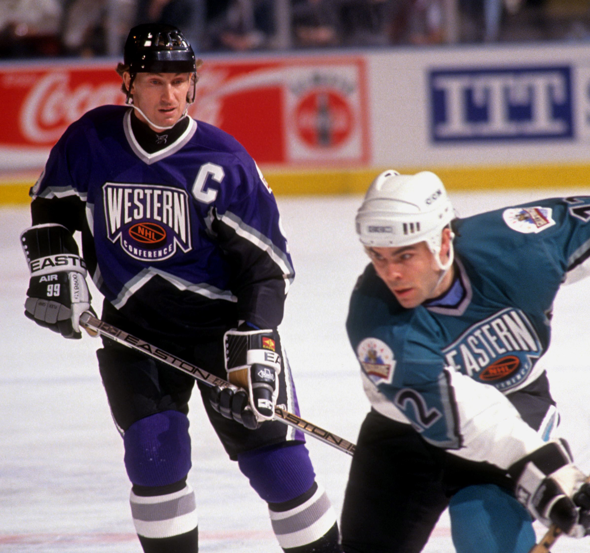 NEW YORK, NY - JANUARY 22: Wayne Gretzky #99 of the Western Conference and the Los Angeles Kings watches Adam Oates #12 of the Eastern Conference and the Boston Bruins skate with the puck during the 1994 45th NHL All-Star Game on January 22, 1994 at the Madison Square Garden in New York, New York. The Eastern Conference defeated the Western Conference 9-8. (Photo by B Bennett/Getty Images)