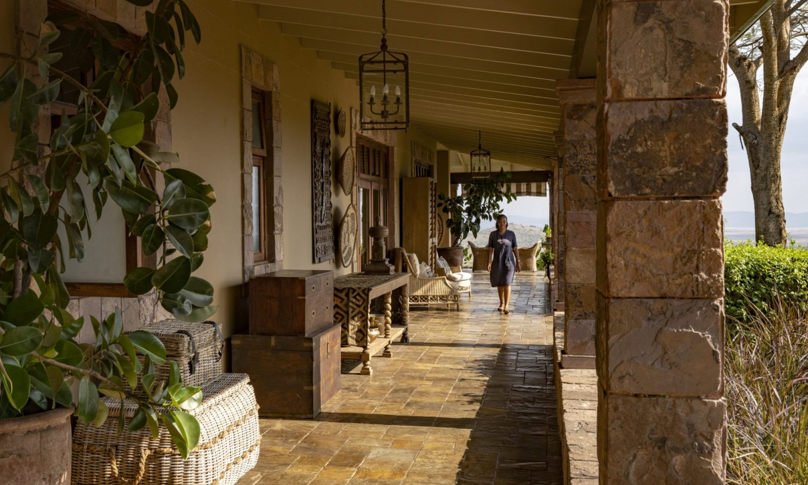Singita Sasakwa Lodge Staff On Verandah