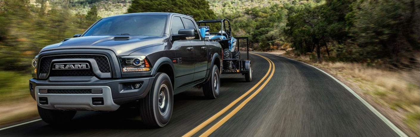 2018 RAM 1500 Towing a Trailer Down the Road