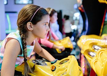 A child plays in the arcade at Camp Breakers