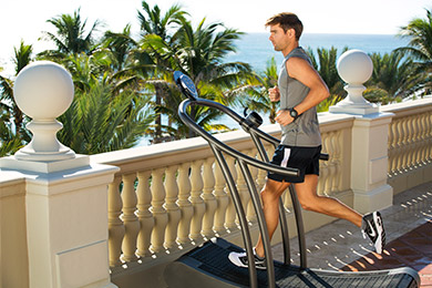 A guest runs on an outdoor treadmill at The Breakers Ocean Fitness center