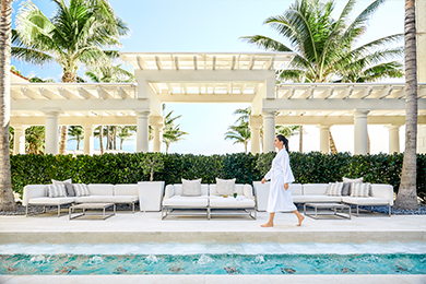 A guest walks in the private courtyard at The Spa at The Breakers