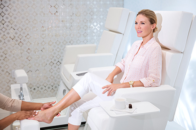 A guest enjoys a pedicure at The Spa at The Breakers