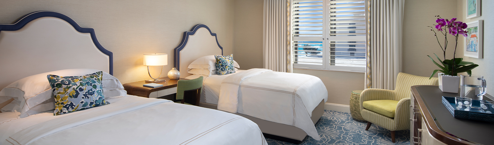 Deluxe Guest Room with Partial Ocean View and Double Beds