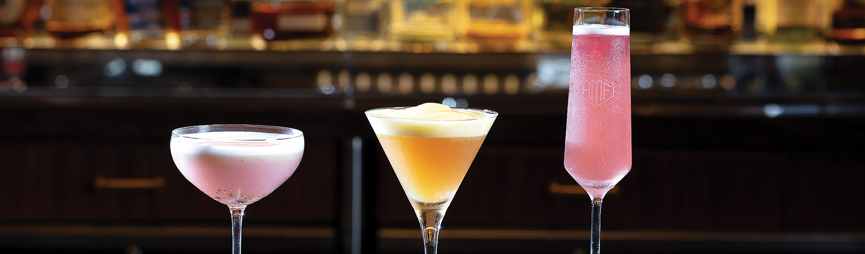 Three cocktails at the bar at HMF at The Breakers