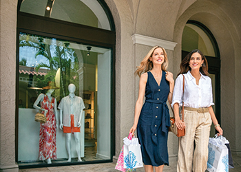 Two women shop at The Breakers' boutiques