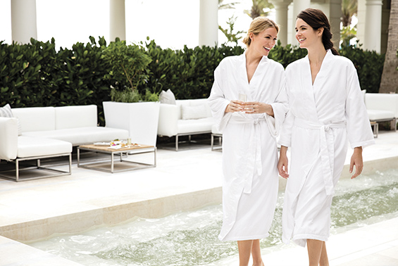 Two guests enjoy the private courtyard at The Spa at The Breakers