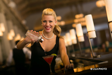 An HMF bartender pours a cocktail