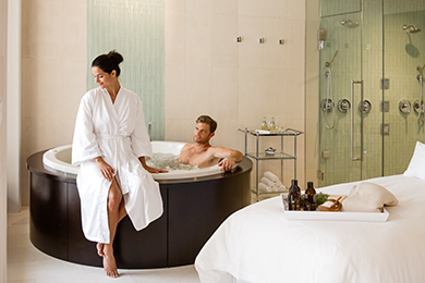 A couple relaxes in the private Spa Suite at The Spa at The Breakers