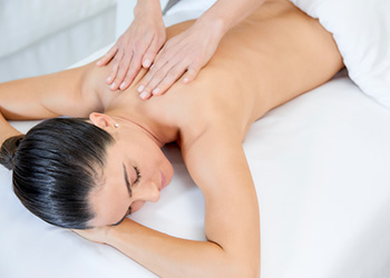 A guest enjoys a massage at The Spa at The Breakers