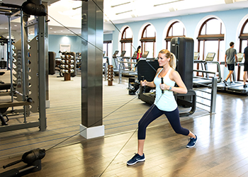 Guests workout inside The Breakers Ocean Fitness center